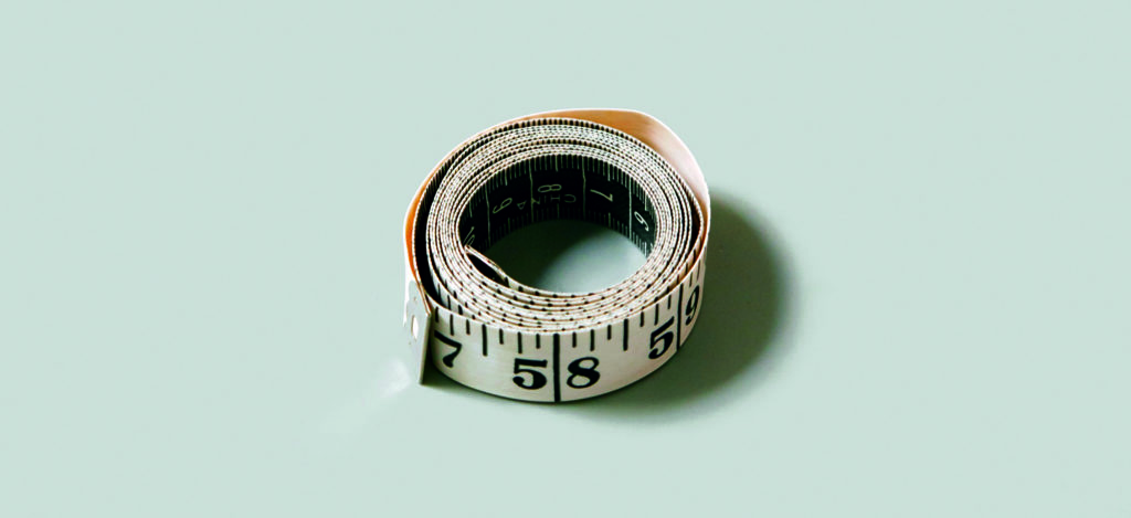A rolled up tape measure with 58 and 59 inches visible