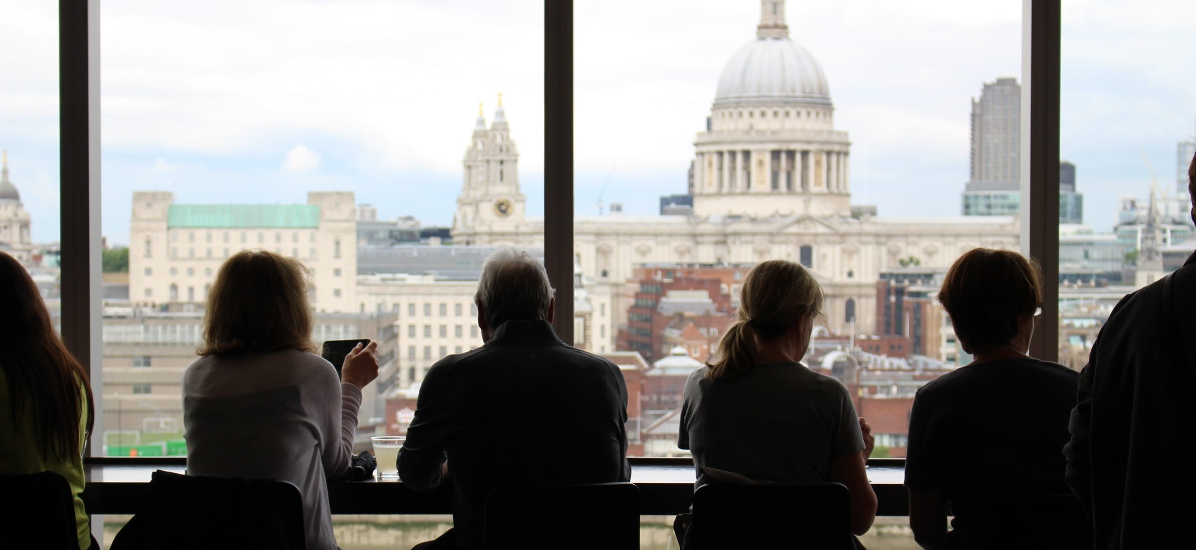 People Sitting in an office looking at St Paul's Cathedral